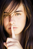 Green eyed woman requesting silence Stock Image