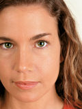 Green eyes. Closeup of a naturally beautiful woman with green eyes royalty free stock photos