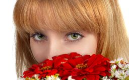 Green eyes and flowers Royalty Free Stock Photography
