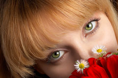 Green eyes and flowers Royalty Free Stock Photos