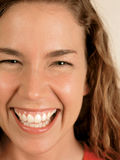 Green eyes laughing. Closeup of a laughing naturally beautiful woman with green eyes royalty free stock photo