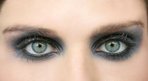 Green eyes woman, black makeup eye shadow. Macro Royalty Free Stock Image