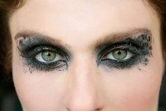Green eyes woman, black makeup eye shadow Royalty Free Stock Images