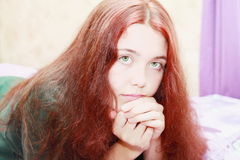 Woman red hair. Beautiful teen girl with long red wavy hair smiling Royalty Free Stock Photo