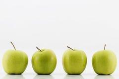 green för äpplen fyra Arkivbilder