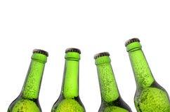green för flaskor fyra Royaltyfri Foto