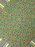 Green fabric. With flowers, natural silk Royalty Free Stock Photos