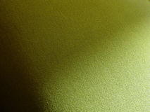 Green fabric. Shadowed green seat or bed cover Royalty Free Stock Image