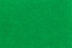 Green fabric background. Texture with fiber thread Royalty Free Stock Photography