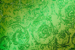 Green fabric can be used as wallpaper. Embroidered  flowers and leaves on the green  canvas background Stock Image