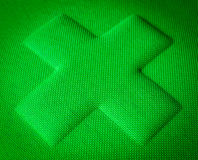 Green Fabric Cross Stock Photography
