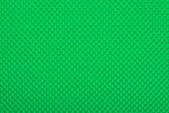 Green fabric with dots, background. Stock Photo