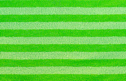 Green fabric striped texture. Clothes background Stock Photo