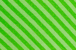 Green fabric striped texture. Clothes background. Royalty Free Stock Photography