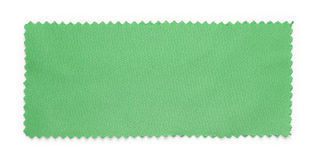 Green fabric swatch samples. Isolated on white background royalty free stock photo