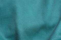 Green fabric texture from a crumpled piece of cloth. On clothes royalty free stock photos