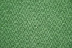 Green fabric texture. Green cloth background. Close up view of green fabric texture and background. Green cloth pattern. stock images