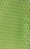 Green Fabric Texture. A lemon -lime shade of green textured fabric with a circular pattern Royalty Free Stock Image