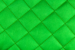 Green fabric texture. Green padded fabric texture closeup Royalty Free Stock Images