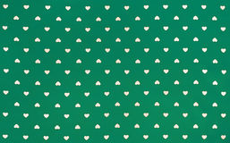 Green Fabric with white hearts pattern, background, retro style Royalty Free Stock Photos