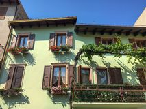 Green facade of a house with balcony Royalty Free Stock Images