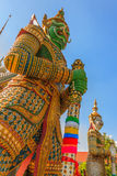 Green Face Giants at Wat Arun Bangkok Stock Photo