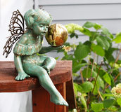 Green Fairy Statue. In garden with golden ball Royalty Free Stock Image