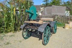 Green fake ancient gun on a cart Royalty Free Stock Photo
