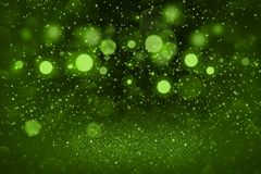 Green fantastic bright glitter lights defocused bokeh abstract background with sparks fly, festive mockup texture with blank space. Green cute sparkling abstract royalty free stock photography