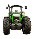 Green farm tractor. On a white background royalty free stock image