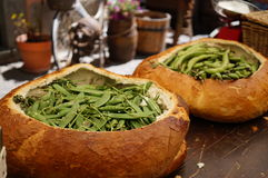 Green fava beans in large bread basket Stock Photography