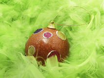 Green feathers and Christmass ball Stock Photography