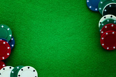 Green felt and playing chips abstract background. Stock Photo