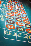 Green felt roulette table with chips played Royalty Free Stock Photos