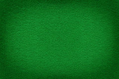 Green felt surface with light copy space in center. Texture and background royalty free stock image