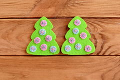 Green felt tree with pink and blue balls on a wooden background. Christmas tree felt sew. Scrapbook embellishment. Home crafts tutorial. Sewing lesson. Step. Top Stock Image