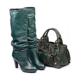 Green female high-heeled boots and leather bag Royalty Free Stock Images