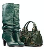 Green female high-heeled boots and leather bag Stock Image