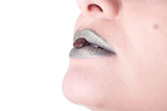 Green female lips with coffee seed Stock Images