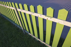 Green fence. A green wooden fence in the evening sunlight Royalty Free Stock Photos