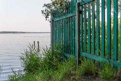 Green Fence. Wood green fence of riverside house Stock Images