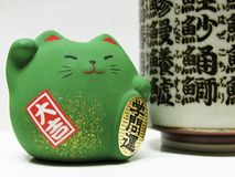 Green Feng Shui Cat. Closeup of a green Feng Shui cat with Japanese Kanji writing, brings academic strength stock photography