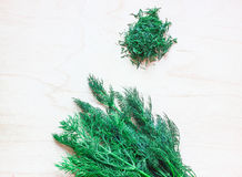 Green fennel on a wooden board. Next to a handful of chopped dill. Fennel close-up Stock Photography