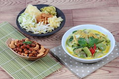 Green fermented flour curry  with  mixed herb and spicy fried textured soy protein curry served with side disk Stock Images