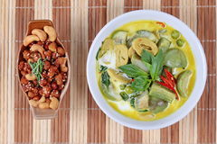 Green fermented flour curry  with  mixed herb and spicy fried textured soy protein curry. Royalty Free Stock Photography