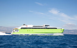 Green ferry spead boat on the greek islands. Stock Photography