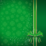 Green festive background with ribbon, bow and leafed clover for St. Patricks Day with free space for text. Green festive background with ribbon, bow and leafed Stock Images
