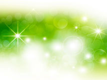 Green festive bokeh background. With stars Stock Photography