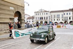 A green Fiat 500C Topolino. ESTE (PD), ITALY - MAY 16: A green Fiat 500C Topolino takes part to the 1000 Miglia classic car race on May 16, 2014 in Este. The car Royalty Free Stock Photography