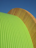 Green fiber optic cable on a timber drum Royalty Free Stock Images